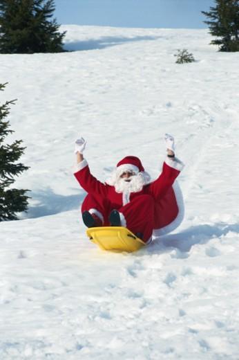 Stock Photo: 1598R-167449 Santaclaus on snowmobile