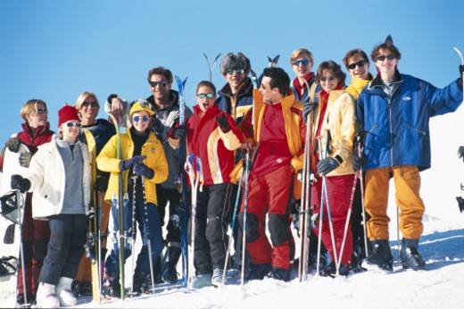Group of people standing together with ski pole : Stock Photo