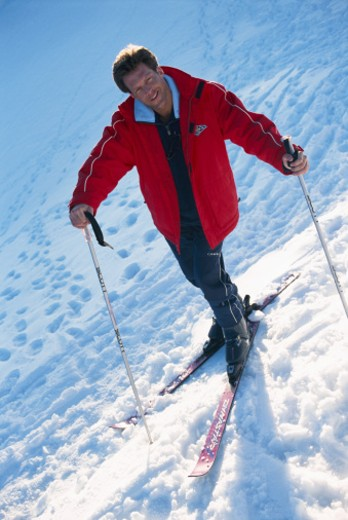 Man skiing in the snow covered mountains, elevated view : Stock Photo