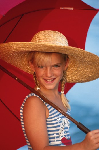 Stock Photo: 1598R-167677 Girl with umbrella, close up