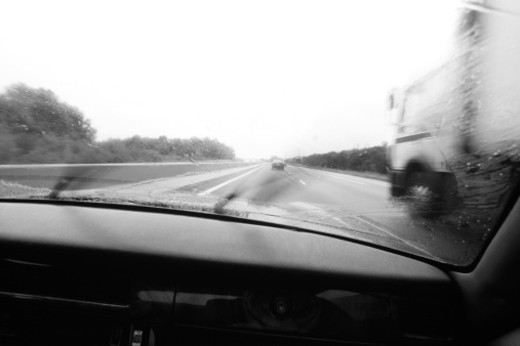 View of wet road from inside car (B&W) : Stock Photo