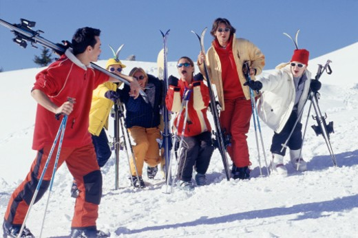 Group of young skiers playing on snow : Stock Photo