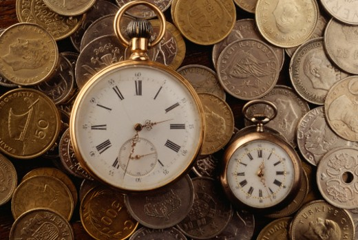 Two vintage clock faces and coins, full frame : Stock Photo