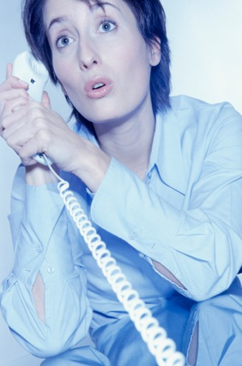 Woman talking on phone : Stock Photo