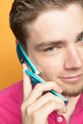 Close-up of a teenage boy using a mobile phone : Stock Photo
