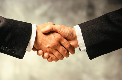 Stock Photo: 1598R-172454 Two businessmen shaking hands, Close-up of hands
