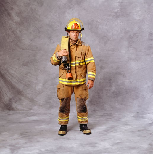 Fire-fighter with fire hose over shoulder, (Portrait) : Stock Photo