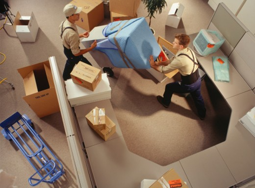 Two removal men moving boxes in office, elevated view : Stock Photo