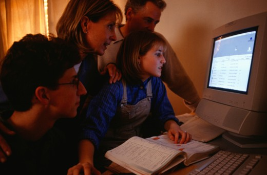 Stock Photo: 1598R-175177 Family using computer at home
