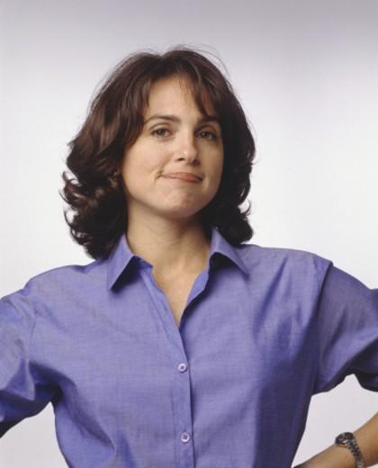 Confident woman posing in studio, (Portrait) : Stock Photo