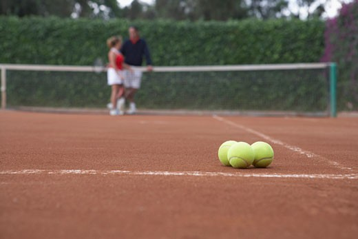 Close-up of tennis balls on a tennis court : Stock Photo