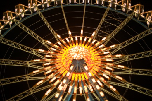 Stock Photo: 1598R-177701 Colourful illumination on Ferris wheel, low angle view