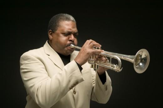 Senior man playing trumpet, posing in studio, portrait : Stock Photo