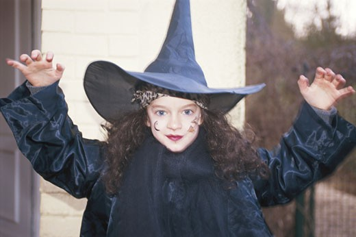 Girl (8-9) wearing witch costume, portrait : Stock Photo