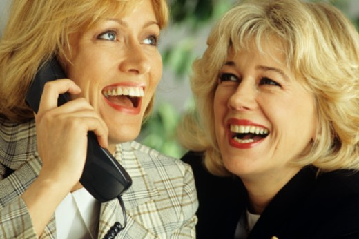 Businesswomen in telephone conversation, close-up : Stock Photo