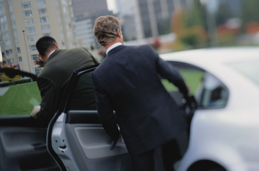 Stock Photo: 1598R-181772 Businessmen Getting Into a Car