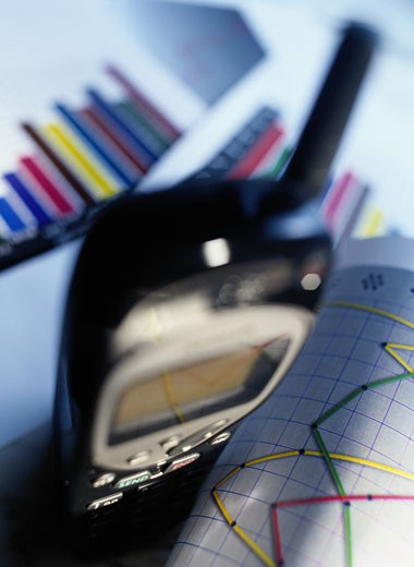 Detail of a Cellular Phone and Charts : Stock Photo