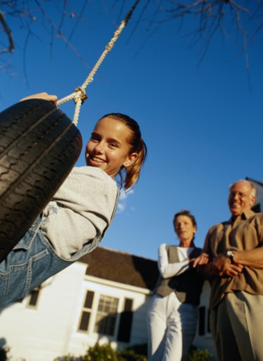 Girl on a Tire Swing : Stock Photo