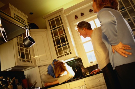 Below View of Parent's Scolding Their Daughter : Stock Photo