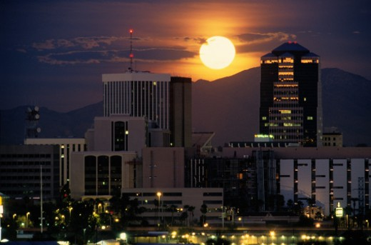 Stock Photo: 1598R-183025 Moonrise Over Tucson, Arizona