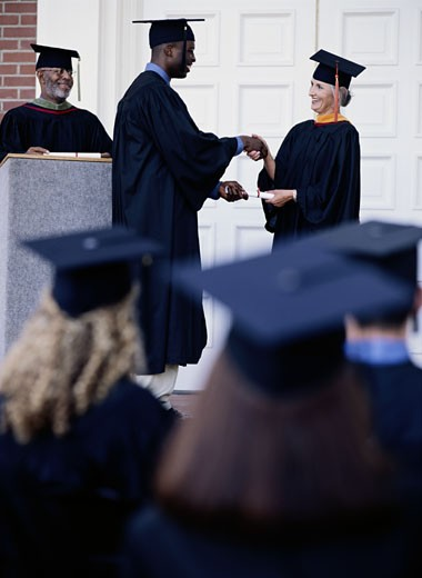 Graduate Receiving a Diploma : Stock Photo