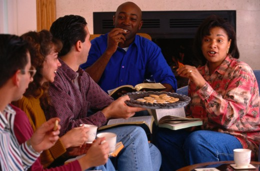 Friends Eating Cookies at a Home Bible Study : Stock Photo