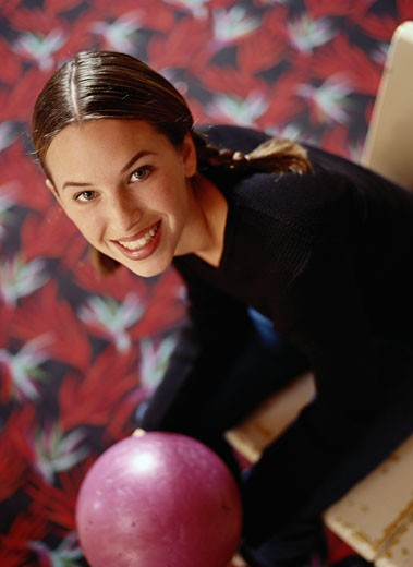 Portrait of a Young Woman Holding a Bowling Ball : Stock Photo