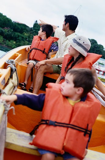 Stock Photo: 1598R-186098 Family Touring in Fishing Boat, St. Lucia