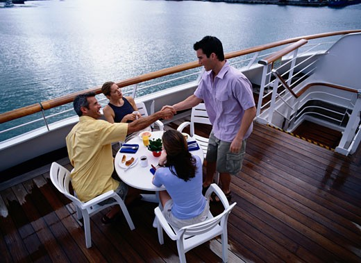 Stock Photo: 1598R-186186 Handshake During a Cruise Ship Meal