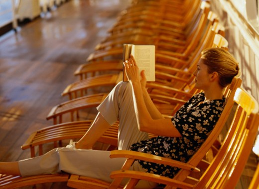 Woman Reading on a Cruise Ship Deck : Stock Photo