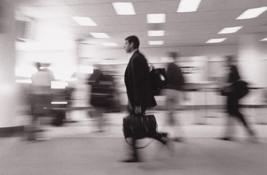 Stock Photo: 1598R-186897 Businessman Running Through Airport with Bags