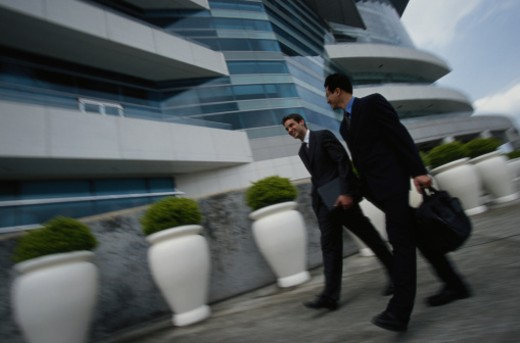 Businessmen Walk into a Building, Hong Kong : Stock Photo