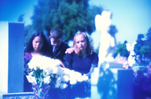Stock Photo: 1598R-187349 Teenagers Mourning at Funeral