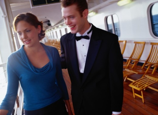 Stock Photo: 1598R-187607 Young Couple Walking on a Cruise Ship Deck