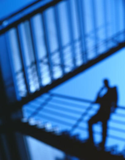 Stock Photo: 1598R-188165 Silhouette of a Businessman on a Stairway