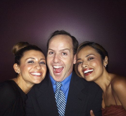 Man with two women smiling, portrait : Stock Photo