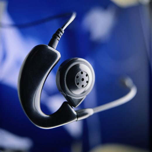 Close-Up of Headset Against Blue Background : Stock Photo