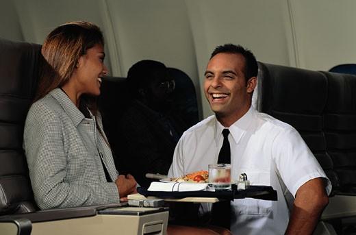 Stock Photo: 1598R-195189 Steward Handing Passenger Salad Plate