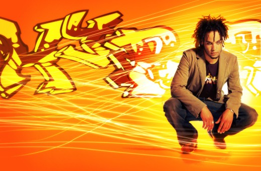 Young man crouching in front of graffiti piece (Digital Composite) : Stock Photo