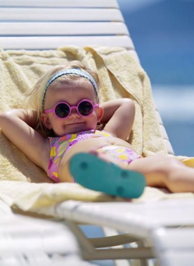 Stock Photo: 1598R-197527 Girl in Beach Chair
