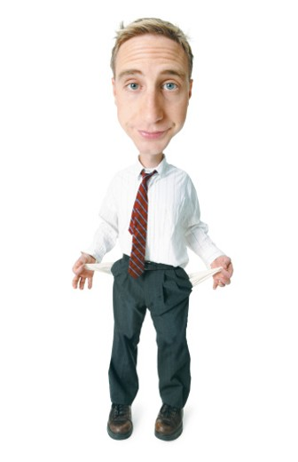 conceptual caricature of a caucasian man in a shirt and tie as he turns his pockets inside out to show that he has no money : Stock Photo