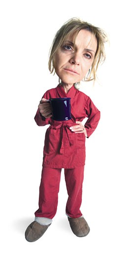 a blonde caucasian woman wearing slippers and red pajamas with a red robe holds her mug and looks very sleepy and people : Stock Photo