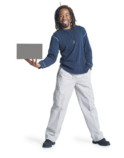 Stock Photo: 1598R-201038 an african american man with dreadlocks wearing kakhi pants and a blue shirt holds a blank sign out to the side of him with one hand and he has his other hand in his pocket