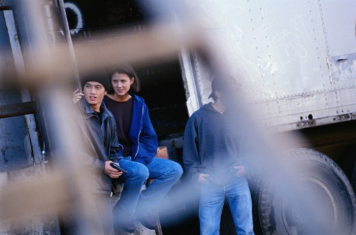 Stock Photo: 1598R-202910 Teens with Gun at Train Car