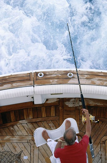 Stock Photo: 1598R-203456 Above of Man Deep Sea Fishing