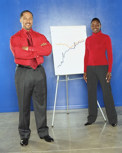 Stock Photo: 1598R-20523 Coworkers standing by line chart, portrait