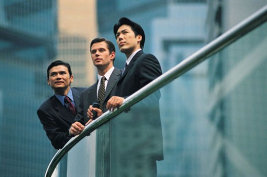 Stock Photo: 1598R-206687 Three professionals leaning on banister