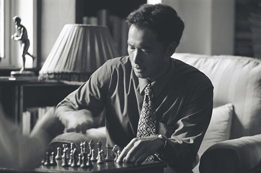Professionals playing chess : Stock Photo