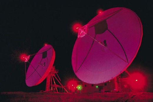 Stock Photo: 1598R-208644 Satellite dishes with red beacons
