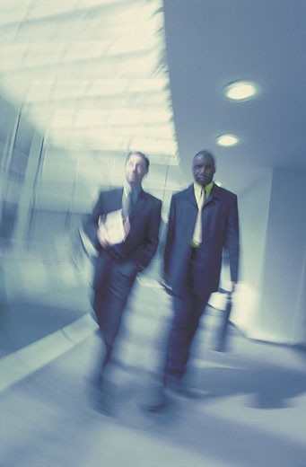 Stock Photo: 1598R-208700 Men walking down office corridor